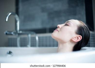 Attractive Mixed Asian Female enjoying bath