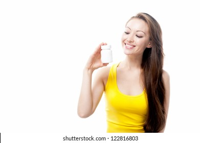 Attractive Mixed Asian female holding supplement bottle and looking at it