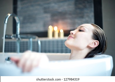 Attractive Mixed Asian Female relaxing in the bath