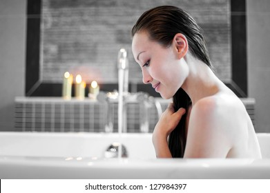 Attractive Mixed Asian Female relaxing and enjoying hair wash in the bath