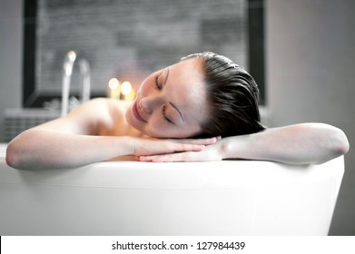 Attractive Mixed Asian Female resting in the bath