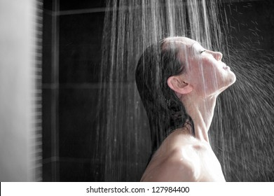 Attractive Mixed Asian Female side view enjoying shower