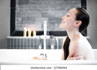 Attractive Mixed Asian Female smiling in the tub
