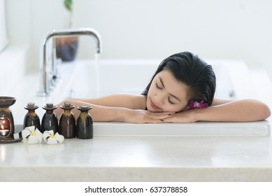 Attractive mixed asian woman relaxing in bath