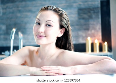 Attractive mixed asian woman smiling in bath