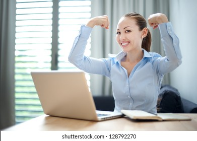Attractive Mixed Business Woman happy showing strength