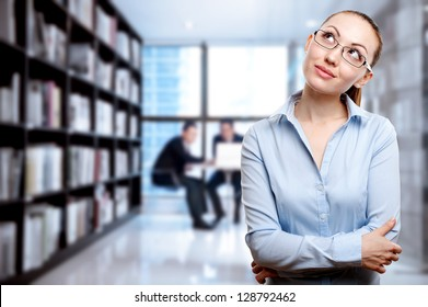 Attractive Mixed Business Woman thinking with business background