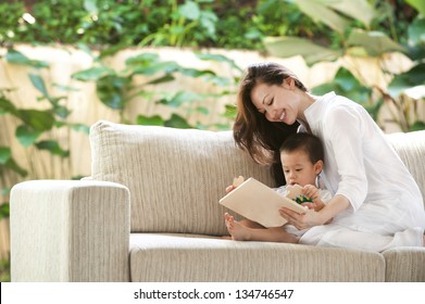 Attractive mixed female lifestyle playing puzzle with child