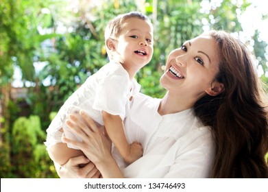 Attractive mixed female lifestyle spending time with child smiling happily