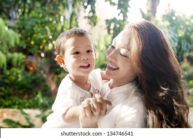 Attractive mixed female lifestyle spending time with happy child