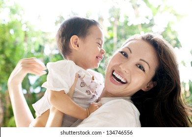 Attractive mixed female lifestyle spending time with child laughing