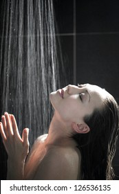 Attractive Mixed Female Taking a shower feeling the water