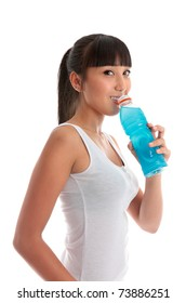 Attractive mixed race girl drinking a sports drink after exercise workout.