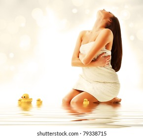 Attractive model in fresh white towel with ducks