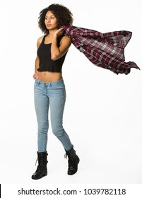 Attractive Model in Jeans and a Tank Top Swinging a Flannel Shirt over Her Shoulder