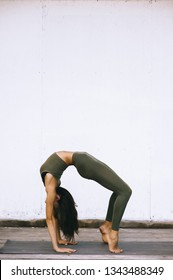 Attractive model in yoga pose on white background in sexual clothes