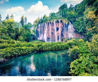 Attractive morning view of Plitvice National Park. Stunning spring scene of green forest with pure water waterfall. Great countryside landscape of Croatia, Europe. Beauty of nature concept background.