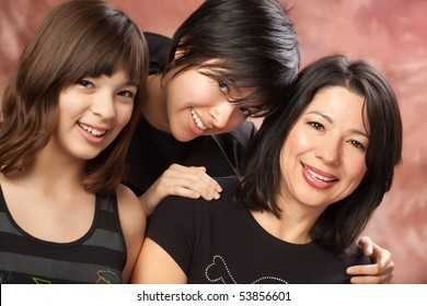 Attractive Multi ethnic Mother and Daughters Studio Portrait.