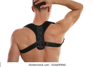 Attractive muscular man with posture corrector. Scoliosis, Kyphosis treatment