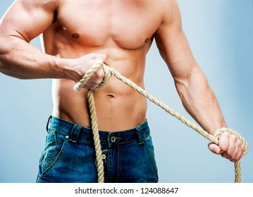 Attractive muscular man torso rope breaks