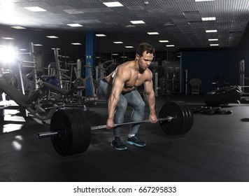 90763c5ef8f7 Attractive muscular shirtless athlete doing heavy deadlift exercise in  modern gym.Functional training.