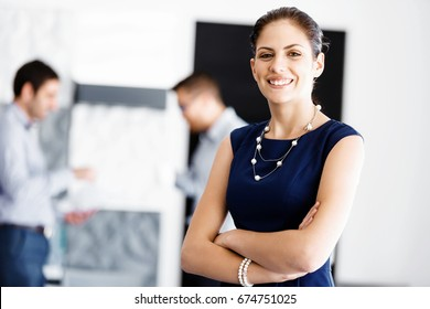 Attractive office worker standing