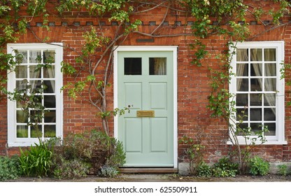 Attractive Old Red Brick House Exterior and Wooden Front Door Seen on a London Street