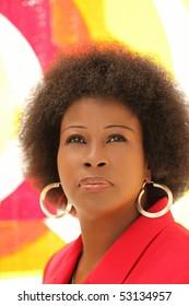 Attractive older black woman outdoor portrait red jacket