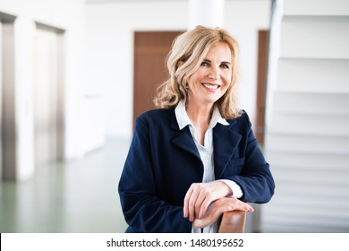 Attractive older businesswoman in an office building