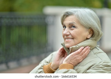 attractive older woman on walk fall