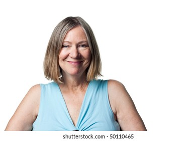 Attractive older woman smiles broadly and happily