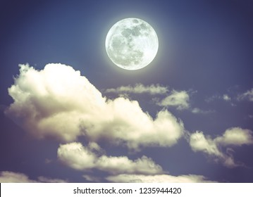 Attractive photo of background nighttime with cloudy. cloudscape of night sky with beautiful full moon, serenity nature background. Vintage effect tone. The moon taken with my own camera.