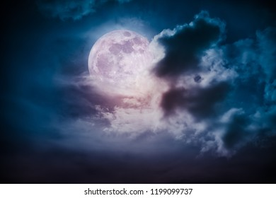 Attractive photo of cloudscape at nighttime. Night landscape of dark blue sky with bright full moon behind clouds, serenity nature background.  The moon taken with my own camera.