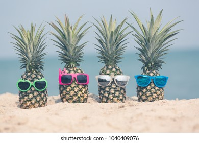 Attractive pineapples on the beach, Tropical summer vacation concept, Sunny day on the beach of tropical island.