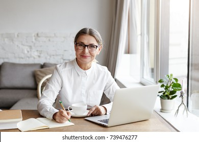 Female writer images stock photos vectors shutterstock attractive positive talented mature woman writer sitting in front of laptop and writing her new book publicscrutiny Gallery
