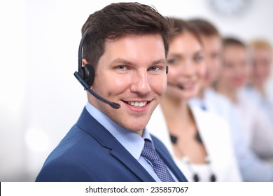 Attractive  positive young businesspeople and colleagues in a call center office