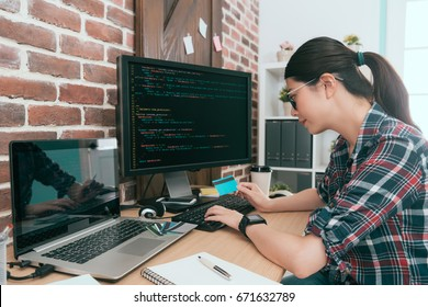 attractive pretty business computer engineer using coding data developing protecting credit card personal information system.