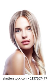 Attractive pretty young woman portrait. Natural make-up, naked shoulder, blond hair, clean skin. Beauty treatment concept. White background.