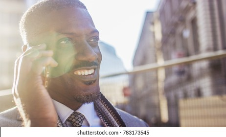 Attractive professional man talking on his phone in the morning light