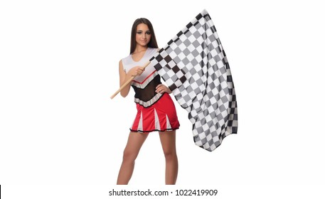 Attractive racing woman waving a race flag and looking at the camera isolate