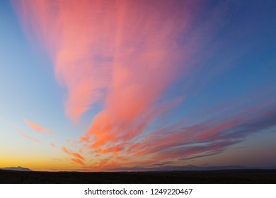 Attractive red vivid clouds illuminated by the beams of the sun. Scenic image of textured sky. Ecology concept - climate change in the environment. Spectacular wallpaper. Discover the beauty of earth.