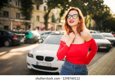 Attractive redhaired woman in eyeglasses 6a7d1b152