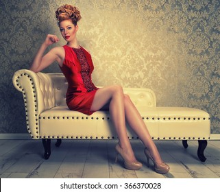 attractive redhaired woman in a red mini dress
