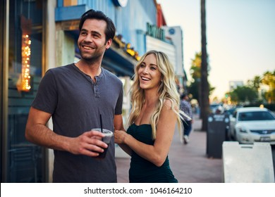 attractive romantic couple spending time together on sidewalk in los angeles
