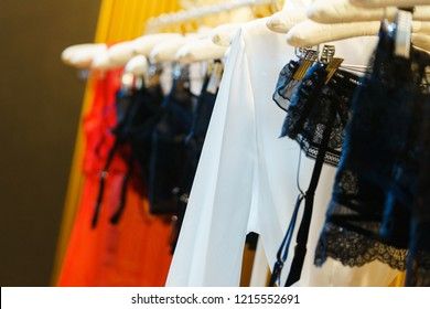 Attractive and seductive lingerie on a hanger in a women's clothing store. Close-up details, lace on a bra and women's lace panties. Sexuality and attractiveness. Sale for the holidays.