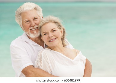 Attractive senior Caucasian couple in white casual clothes on a tropical vacation beach
