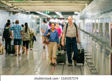 Attractive Senior couple with suitcases are ready for traveling.