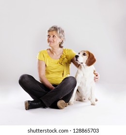Attractive senior woman is talking to her dog