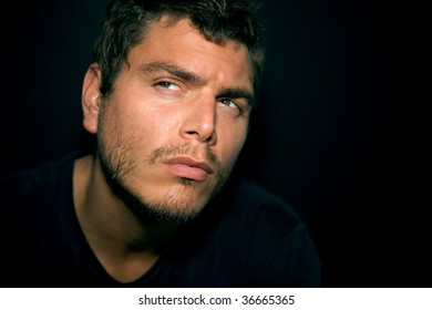 An Attractive Serious Young Man with scruff