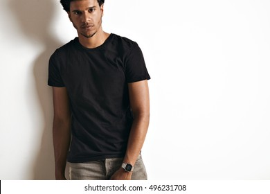 Attractive sexy African American young man wearing a blank cotton black t-shirt isolated on white
